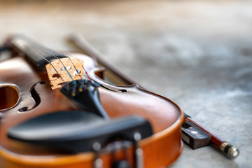 Close up, shallow dept of field photo of violin and bow