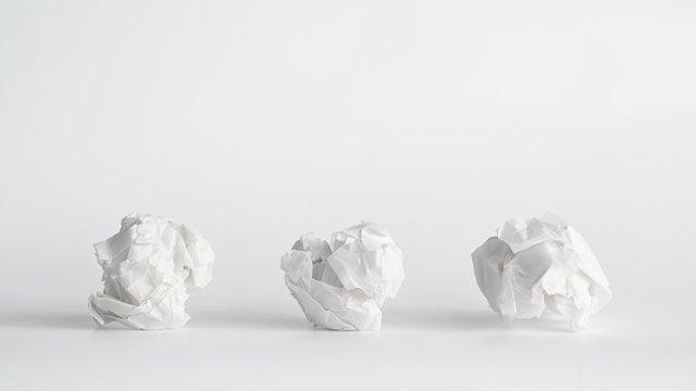 Three paper crumpled a symbol for three concept ideas