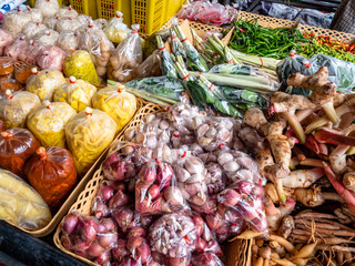 Pattaya, Thailand - August 1, 2019: Collection of fresh Fruits, vegetables, herbs and spices found at the local thai market stalls