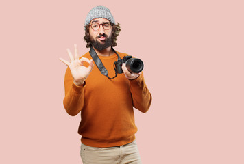 young bearded man with photo camera