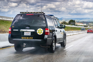 March 20, 2019 Los Angeles / CA / USA - Police car driving on the freeway