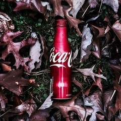 Bottle of coca-cola in a pile of fall leaves