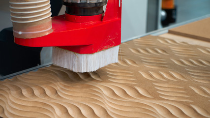 Processing of panels on the coordinate-milling woodworking machine with CNC.