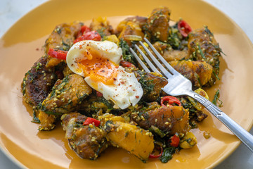 Fried pumpkin with spices together soft-boiled egg