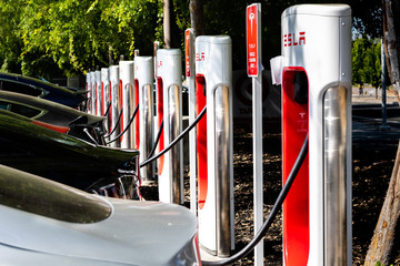May 5, 2019 San Jose / CA / USA - Tesla vehicles plugged in at a charging station in south San Francisco bay area; Silicon Valley