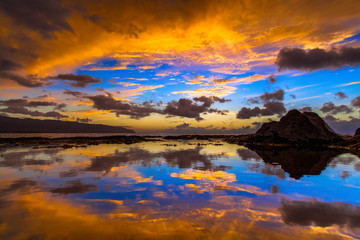 Wall Mural - Amazing North Shore Oahu sunset reflected in a tide pool