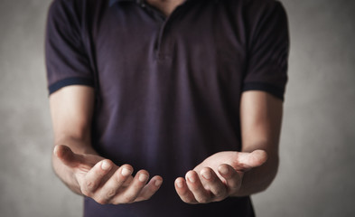 Man showing empty opened hands.