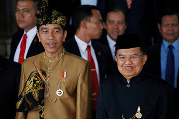 Indonesia's President Joko Widodo and Vice President Jusuf Kalla depart after the president's address ahead of Independence Day at the parliament building in Jakarta