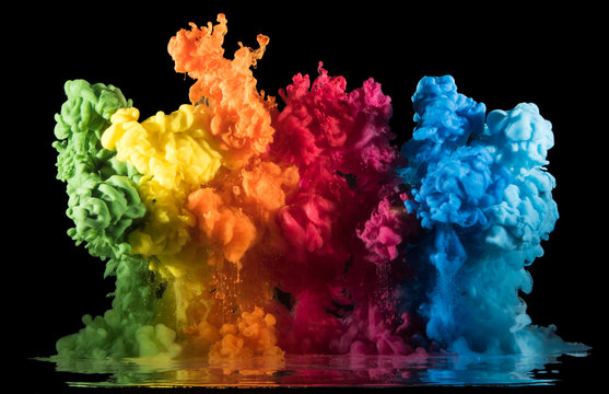 Colorful paint drops from above mixing in water. Ink swirling underwater.