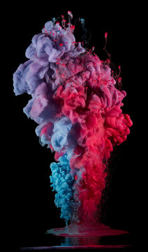 Paint drops from above mixing in water. Ink swirling underwater. Pink, purple, blue colors