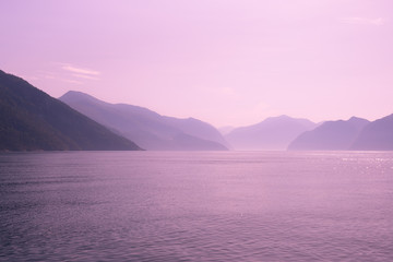 View of fjord at sunset.