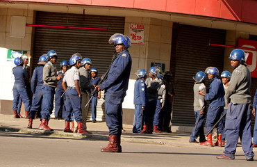 Riot police patrol the streets after police earlier banned planned protests by the opposition party Movement for Democratic Change (MDC) in Harare