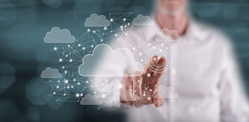Man touching a cloud networking concept