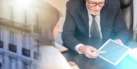 Woman meeting financial adviser in office; multiple exposure