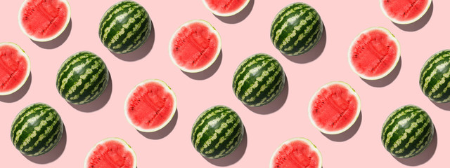 Foto op Plexiglas Keuken Colorful fruit background of fresh half watermelon on pink background