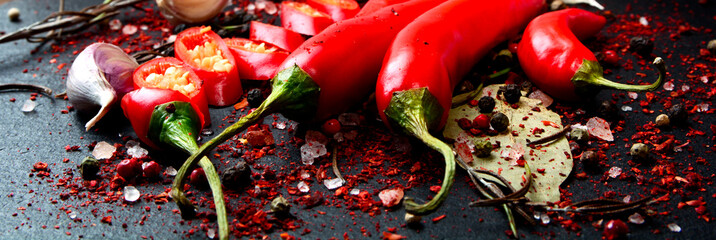 Fresh Chili pepper on dark background. Close-up