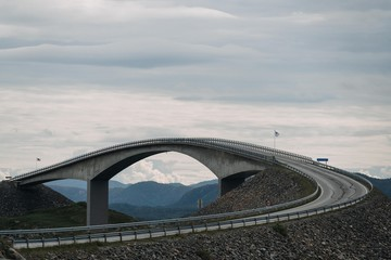Shot of a long overpass road near mountains under the sky Fototapete