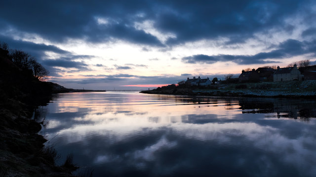 Reflections in the River Brora at sunrise