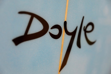 A logo of a Doyle surfboard manufactured in China is shown at the company's warehouse in Lake Forest, California