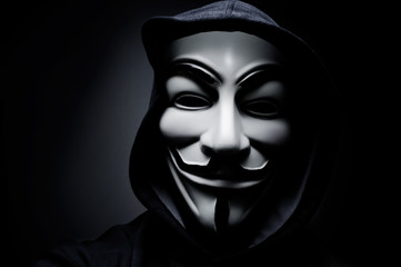 man wearing Vendetta mask. This mask is a well-known symbol for the online hacktivist group Anonymous