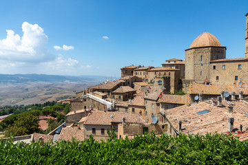 Tuscany, Volterra town skyline, church and panorama view on sunset. Maremma, Italy