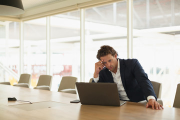 Businessman using laptop in the conference room at office