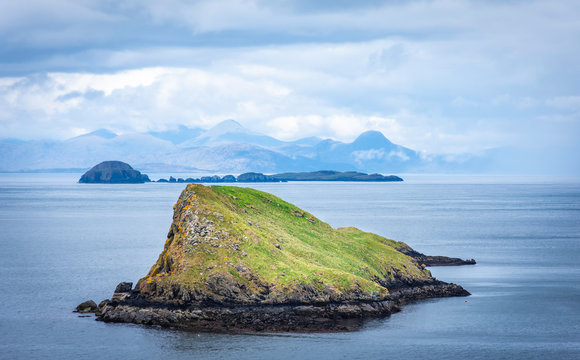 Tranquil landscape of Isle of Skye, Scotland,UK.Small islands on sea and mountains in background.