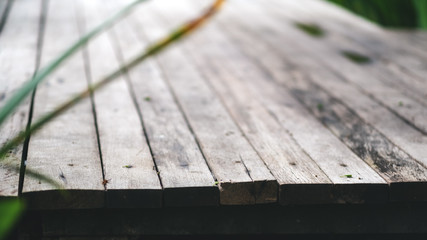 Closeup image of an old wooden terrace in the outdoors background and texture