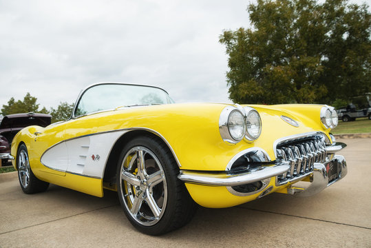 A front side view of a yellow 1958 Corvette Chevrolet classic car on October 21, 2017 in Westlake, Texas.