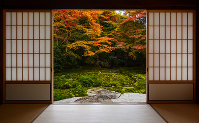 Autumn colors framed by traditional Japanese sliding doors and tatami mats