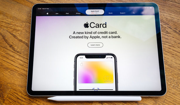 Paris, France - Mar 27, 2019: POV personal perspective on Apple webpage seen on modern iPad Pro tablet featuring the new subscription model for Apple Card