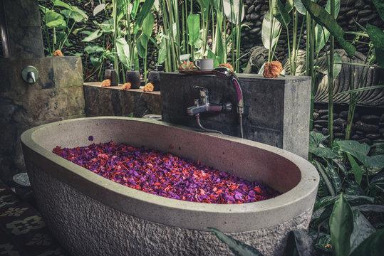 Bath tub with flower petals