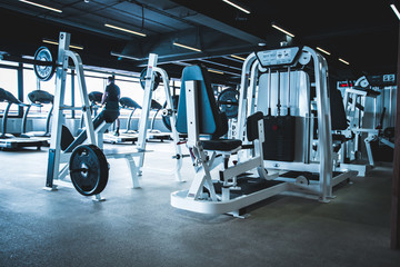 Poster Fitness gym interior with equipment.fitness center interior