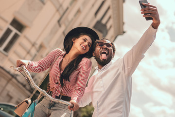 Showing tongue for funny selfie stock photo
