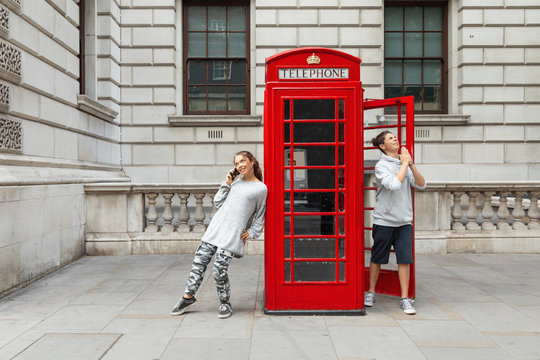 Two boys and a telephone box in London