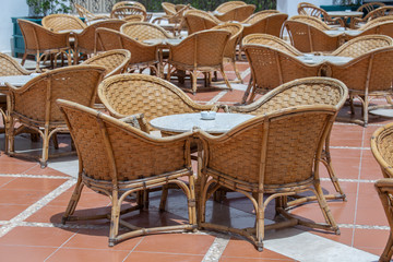 Rattan table and chairs in beach cafe next to the red sea in Sharm el Sheikh, Egypt