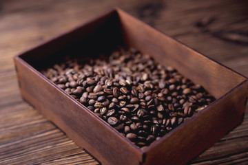 Poster Café en grains natural coffee beans in a wooden box on a natural wooden background soft backlight