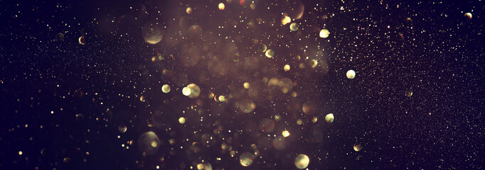 blackground of abstract glitter lights. blue, gold and black. de focused. banner Wall mural