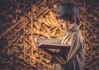 Muslim Boy Reading Holy Islamic Book Quran