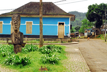 Sao Tome, Angolares, big wooden carved statue in the middle of garden of the central plaza