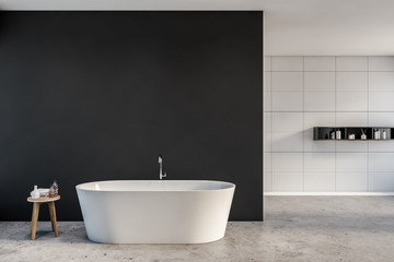 Gray and white tile bathroom with bathtub