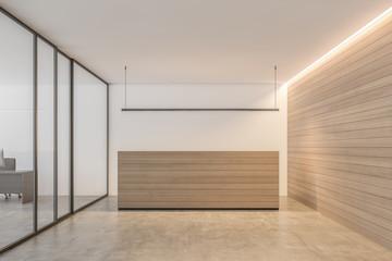 Wooden reception desk in white office