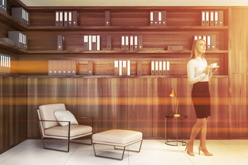 Blonde businesswoman in wooden office lounge Wall mural