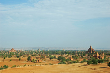 Wall Mural - Myanmar, Bagan, Vast arid plain of ancient buddhist temples and bushes