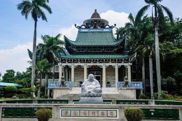 Zelfklevend Fotobehang Historisch mon. Buddhist statue before the Taoist temple in Davao, Mindanao, Philippines