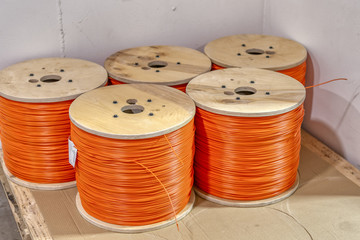 Coils with detonation cord. Multi-colored wire of orange and yellow.