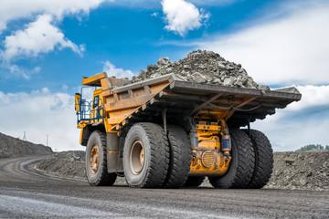 Rock transportation by dump trucks.
