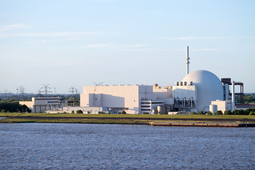 BROKDORF, GERMANY - June 4, 2017: Riverside view of Brokdorf Nuclear Power Plant. It started in October 1986 and the decommissioning is planned for 2021.