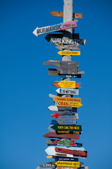 Falkland Island, Stanley (aka Port Stanley). Stanley Totem Pole, colorful directional signs to international locations from Stanley.