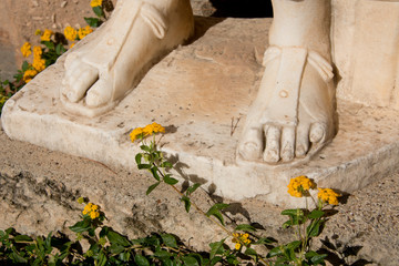 Greece, Corinth, Ancient Corinth. Once the wealthiest city in Greece, St. Paul introduced the city to Christianity. Carved marble statue, detail of feet with sandals..